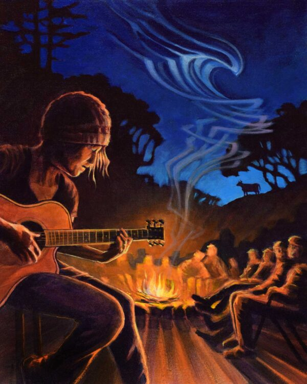 My wife rocking out on guitar by a campfire on a cattle ranch